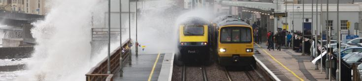 Photo of trains in Dawlish railway station during a storm. istock.com/morefam.=